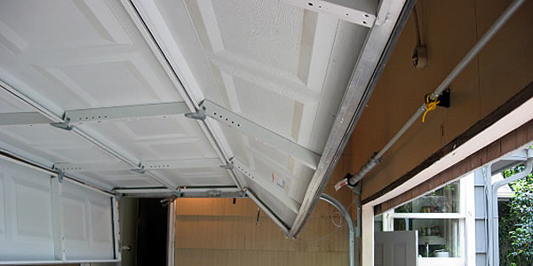 Garage Door Off Track in Dayton? on low profile garage door track, garage door high lift track, bifold door track, computer off track, zero clearance garage door track, patio door off track, pocket door off track, closet door off track, garage door extension track, interior sliding doors on track, car door off track, garage door bottom track, siding door off track, curved door track, garage cables, garage roll up doors, garage door low headroom track, garage door sliding track, used garage door track, sliding doors off track,